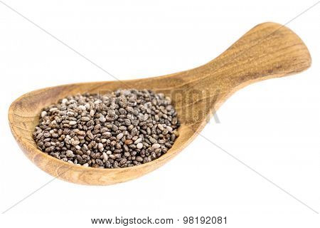 chia seeds on  a small wooden tablespoon isolated on white, selective focus