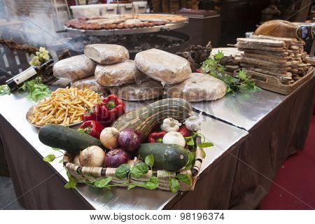 Bread, fresh vegetables zucchini garlic bell pepper onion, at the fair in Spain.