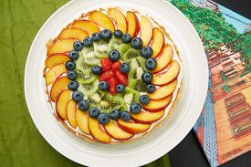 Delicious Fruit Cake On A White Round Plate
