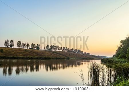 Morning sunrise over the lake with shore
