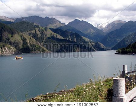 Tianchi Lake(Heaven's Lake) A beautiful lake in Tianshan mountains Xinjiang China.Tianchi Lake 's elevation is 1980 meters 3.5 kilometers long the deepest place of the lake is 103 meters.