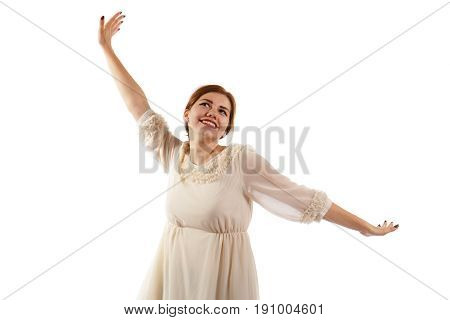 A happy lady smiling and standing on white background