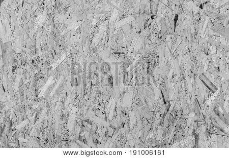 Background of sawdust. Wall of pressed wood sawdust. Monochrome
