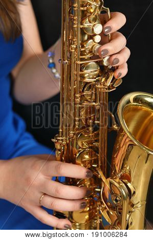 Close-up of a saxophone in female hands