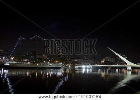 Dusk And Woman Bridge On Puerto Madero Neighborghood Or Disctrict In Buenos Aires City, Argentina