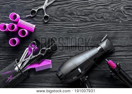 Hairdresser set on grey wooden background top view.