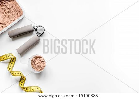 sport diet nutrition and fitness equipment , bars and measure tape on white background top view mock up