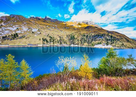 Glacial lake with clear cold water.The concept of ecological tourism. The harmony of the Dolomites. Mountain Lake Lago di Fedaia