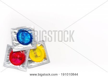 male contraception for safe sex with condoms on white desk background top view mockup