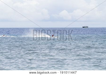 Dumaguete Philippines - 13 May 2017: sea landscape with boats and local sailors. Motor boats race in sea. Marine racing championship. High speed motorboat sail. Sea water fountain. Sport speedboat