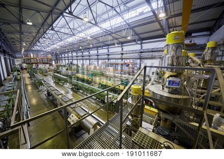 MOSCOW, RUSSIA - MAR 01, 2017: Workshop with extruders for producing plastic pipes at Sinikon factory. The joint Russian-Italian company Sinikon was founded in 1996.