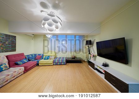 MOSCOW, RUSSIA - MAR 1, 2017: Interior of room with many sofas at walls and big TV screen.