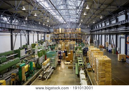 MOSCOW, RUSSIA - MAR 01, 2017: People work on conveyor in large workshop at Sinikon factory. The joint Russian-Italian company Sinikon was founded in 1996.