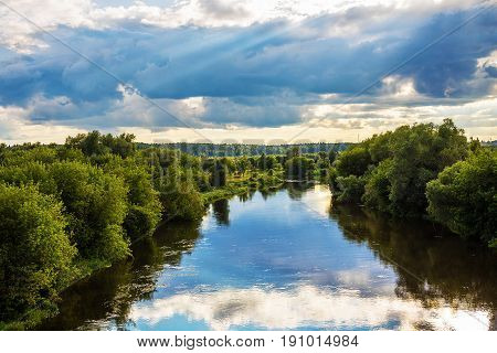Evening landscape with dramatic sky with clouds and river, Zvenigorod, Russia
