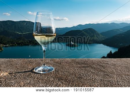 A glass of wine against the backdrop of Lake Bled, in Slovenia. Europe, otddyh, tourism.