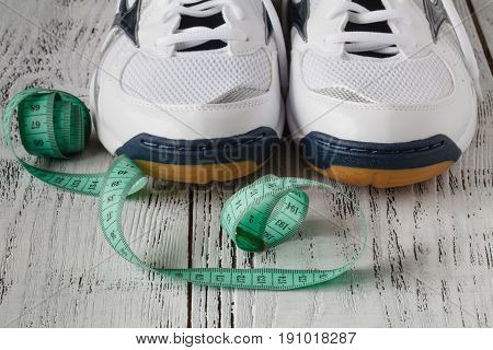 Pair Of Sneakers Isolated On The Reclaimed Wood Background