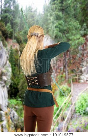 back of female elf shooting a bow and arrow