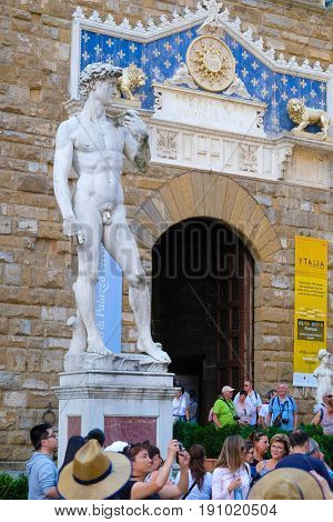 Florence, Italy - June, 5, 2017: visitors in Uffizi gallery yard in Florence, Italy near the sculpture of David from Michelangelo