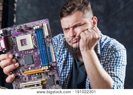 Service engineer fixing problem with motherboard