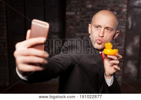 Special agent makes selfie with little toy duck