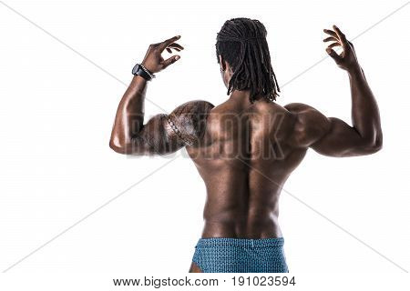 Back of African American bodybuilder man, naked muscular torso, wearing bathing suit, isolated on white background