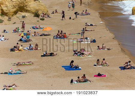 LAGOS, PORTUGAL - APRIL 23, 2017: People at the famous beach of Praia Dona Ana in Lagos, Algarve region, Portugal