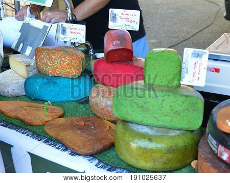 BEDOIN, FRANCE - AUGUST 1, 2016: French cheese of differents color at the market in Provence.France.