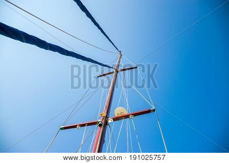 The Rolled Sail Is Attached To A Tall Mast. Preparation For Departure To The Open Sea.