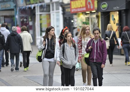 Galway Ireland July 2017 Group Of Erasmus Students Walking down Shop Street