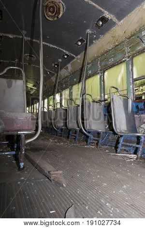 Seats On Aisle Of Abandoned Trolley Car