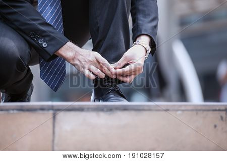 Businessman Tie Shoelace Or Lace Up Black Shoes On Floor, Close Up.