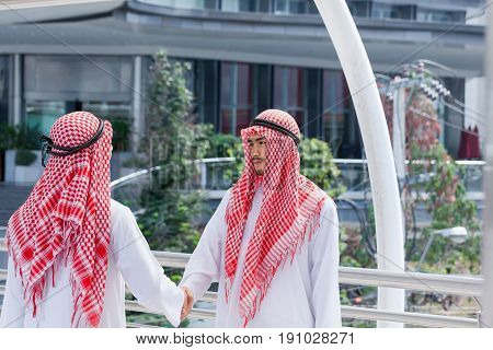 two arabian businessman shake hand and make decision together in modern city
