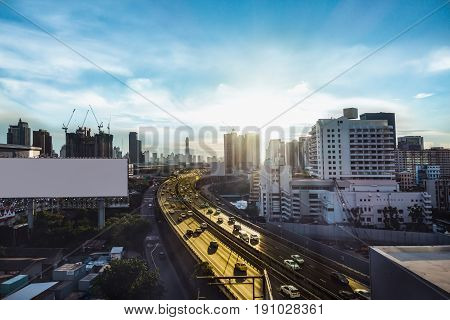 Road Traffic Transportation And City In Bangkok At Twilight Sunray And White Big Billboard