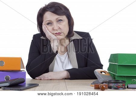 Tired sad business woman at work table