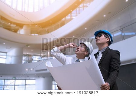 Asian Businessman And Engineer Architect Professional Occupation Corporate City Looking Away And Hol