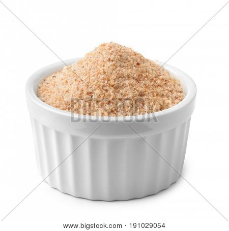 Ramekin with bread crumbs isolated on white