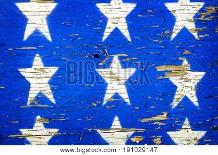Painted blue stars on rough wooden board