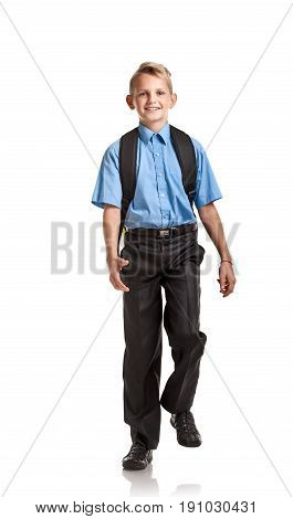 Confident happy boy with schoolbag going to school on white background