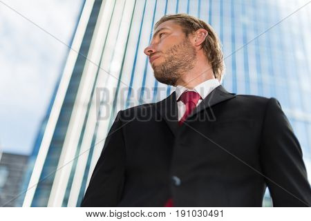 Portrait of an handsome businessman in front of his office building