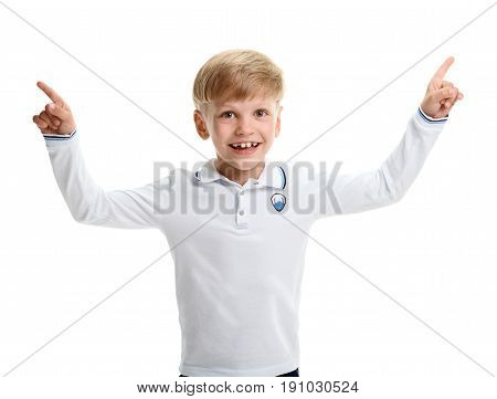 Excited smiling young boy pointing in up directions