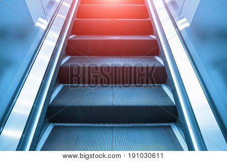 Escalator and step inside building and shop.