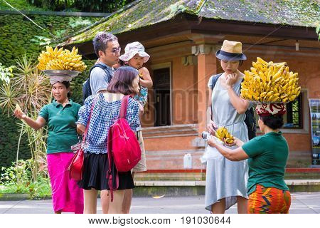 Woman Selling Bananas At Tirta Empul Hindu Balinese Temple With Holy Spring Water In Bali, Indonesia