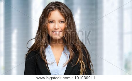 Smiling businesswoman in a modern office
