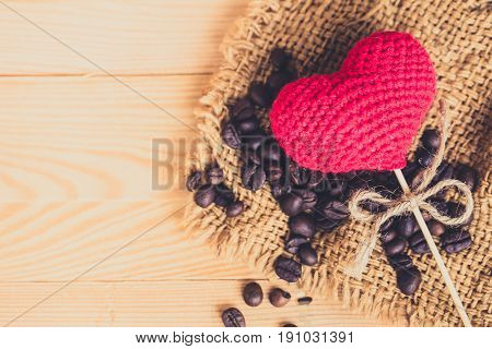 Coffee Bean With Heart On Wood Background, Happy Love Drink Coffee Concept.