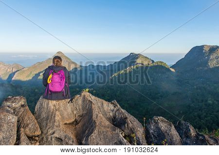 Woman On Top Of Mountain Sitting On The Rock Watching A View Landscape At Doi Luang Chiang Dao, Chia