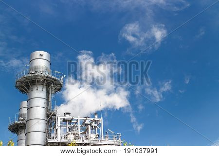 exhaust pipe rejects smoke to air on blue sky background