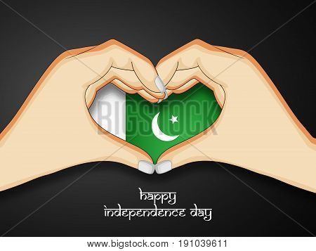 illustration of hands and heart in Pakistan flag background with Happy Independence Day text on the occasion of Pakistan Independence day
