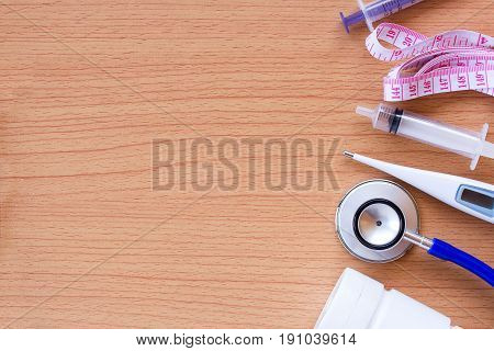 Workplace of a doctor with medical equipment on wooden desk background. Top view with copy space. Healty concept.
