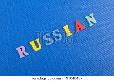 Russia word on blue background composed from colorful abc alphabet block wooden letters, copy space for ad text. Learning english concept