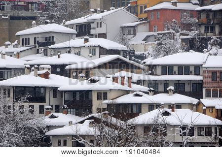 VELIKO TARNOVO BULGARIA - JANUARY 19 2017: Closeup houses on the hill in the winter
